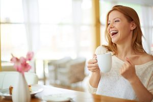 carefree-woman-with-a-cup-of-coffee
